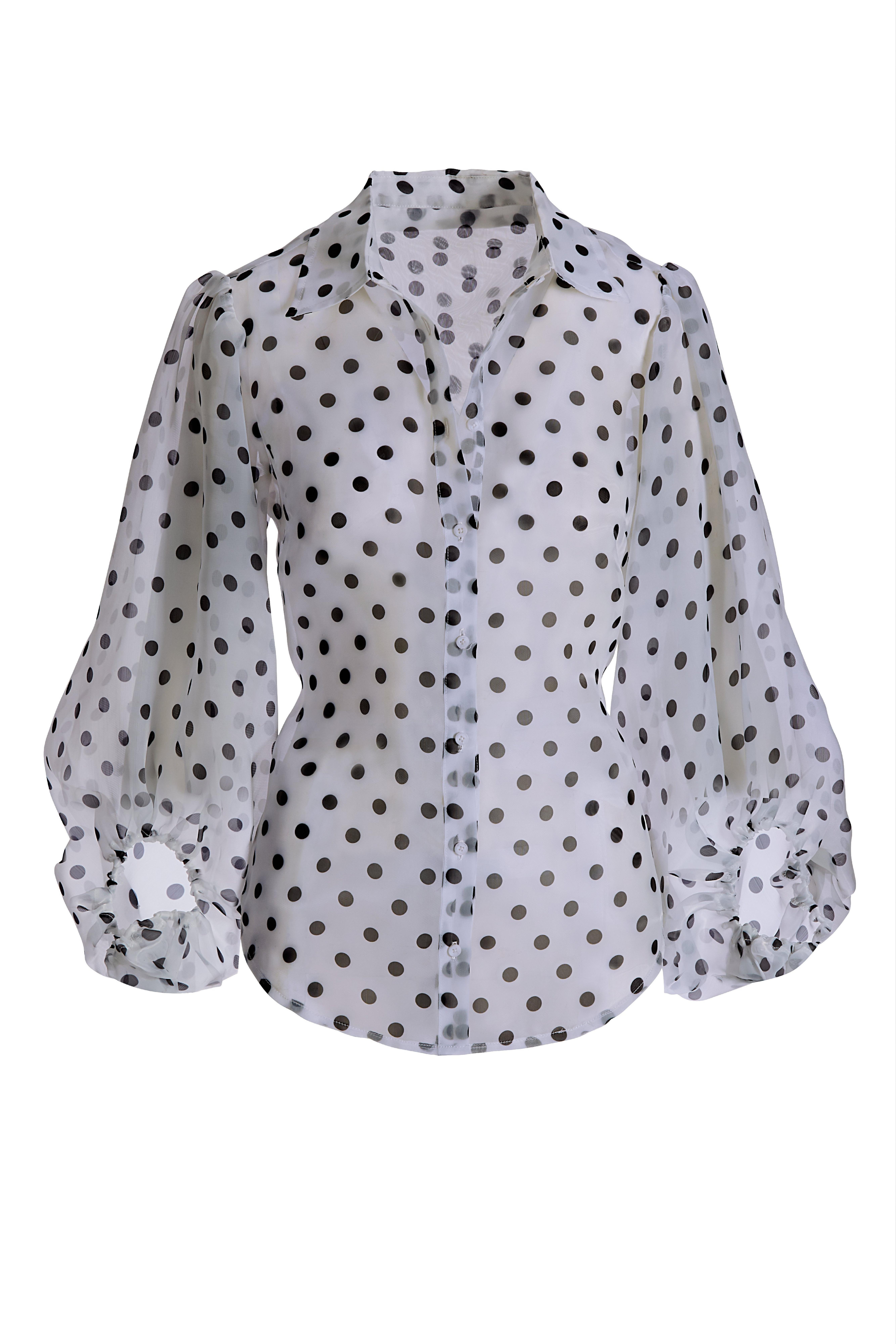black and white polka dot long-sleeve top.