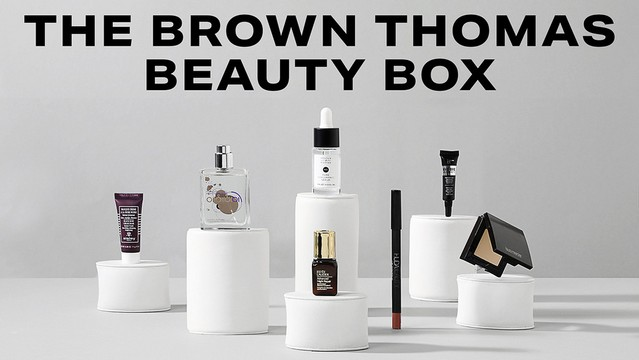an arrangement of beauty products on small pedestals