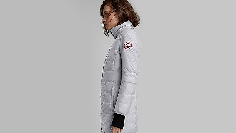 a woman in a grey canada goose puffa jacket