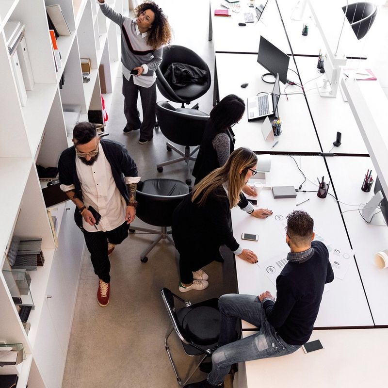 Ariel shot of 5 people working around an open plan office