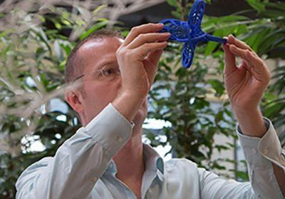 Man looking at 3D printed bird