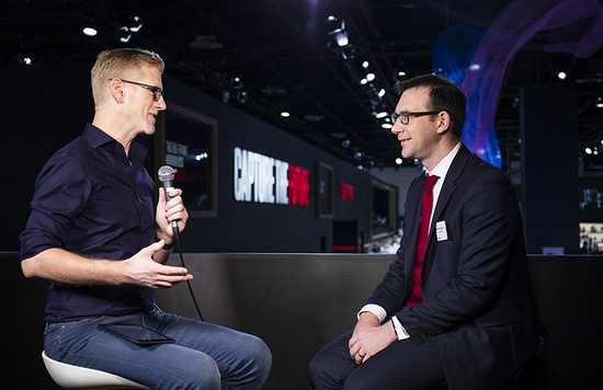 Image from an event of an interviwer interviewing a Canon Product specialist