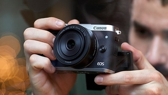 Image of a Male shooting with a Canon consumer camera