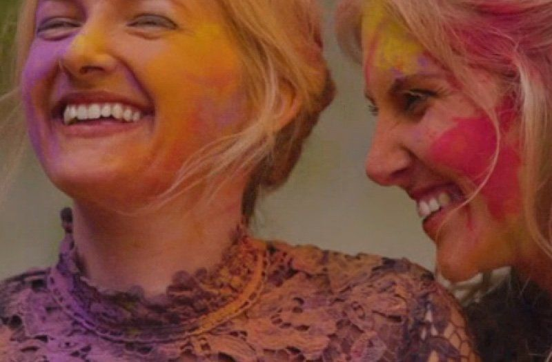 Close up view of 2 women smiling