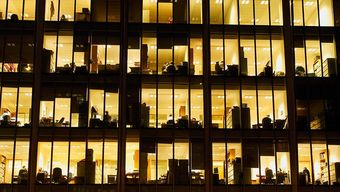 Outside large office building with lights on