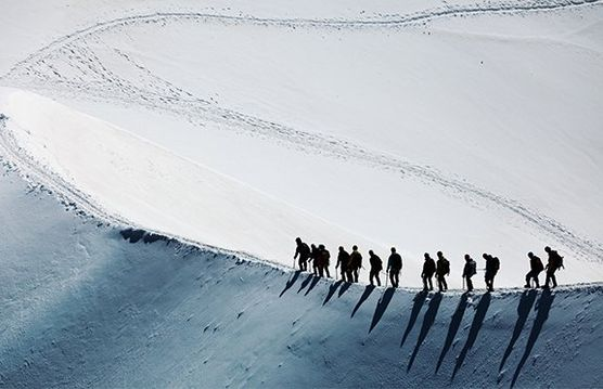 Group of people on a hike in the snow