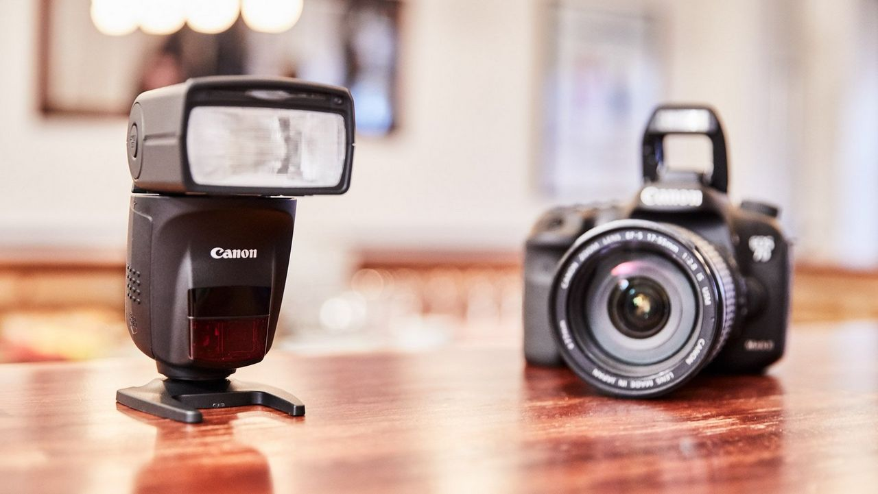Canon 6D Mark II and Canon Speedlite 470EX-AI on a brown table