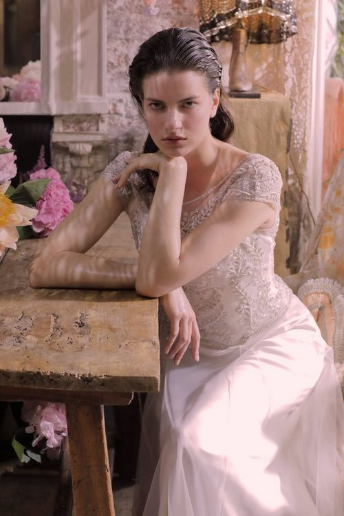 Fashion Shot - Woman in white dress sitting at a table - taken with a EOS 5D Mark IV