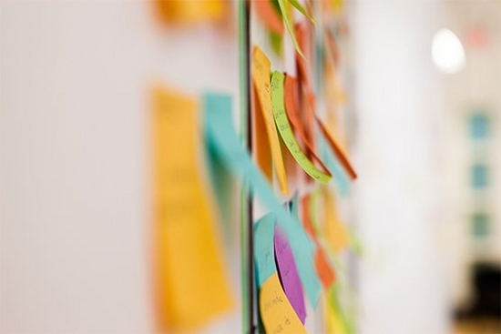 Coloured postit notes on a whiteboard