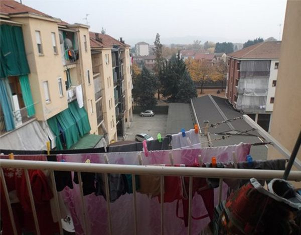 Laundry hanging on an apartment balcony
