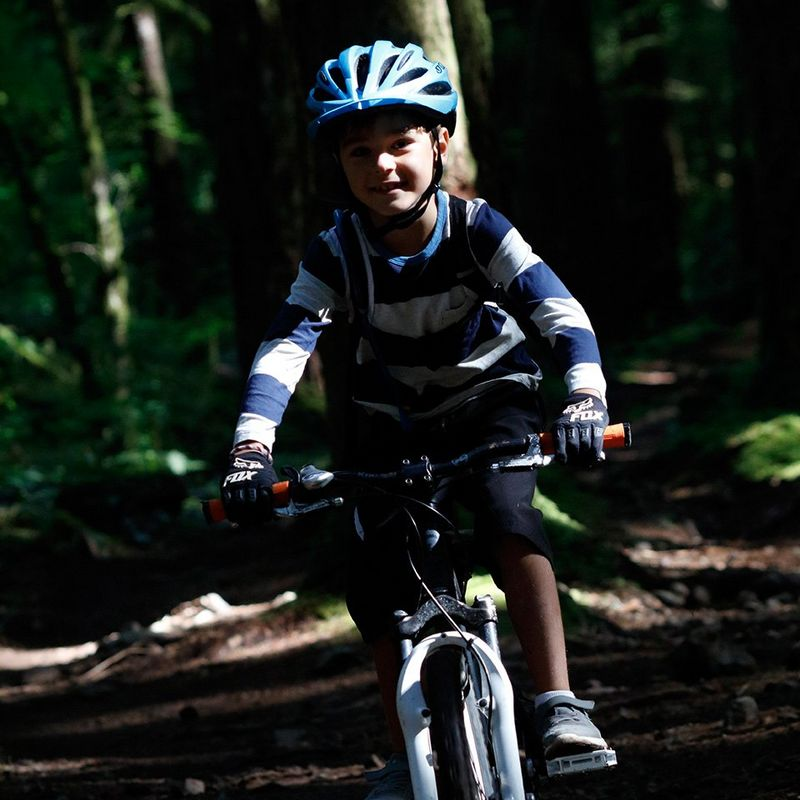 Low light close up child bike ride