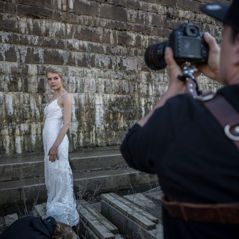 Photographer taking a picture of the bride