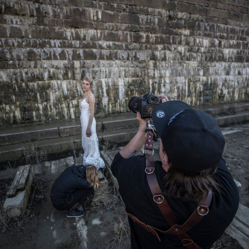 Photographer taking a picture of the bride with a Canon camera
