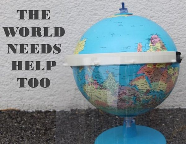 A photo of a globe 'wearing' a plastic PPE visor, accompanied by the caption 'the world needs help too'