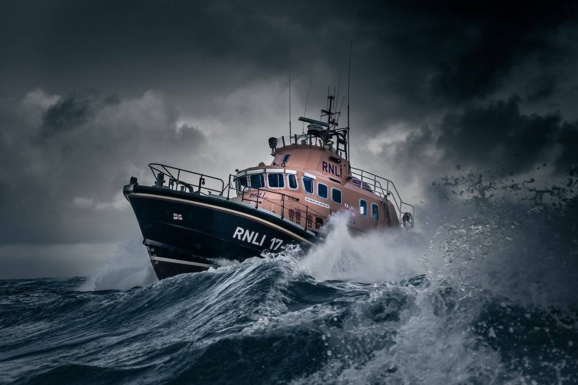 Islay's RNLI lifeboat Helmut Schroder of Dunlossit II sailing through thrashing seas.