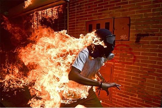 Venezuelan photographer Ronaldo Schemidt wins World Press Photo of the Year Award