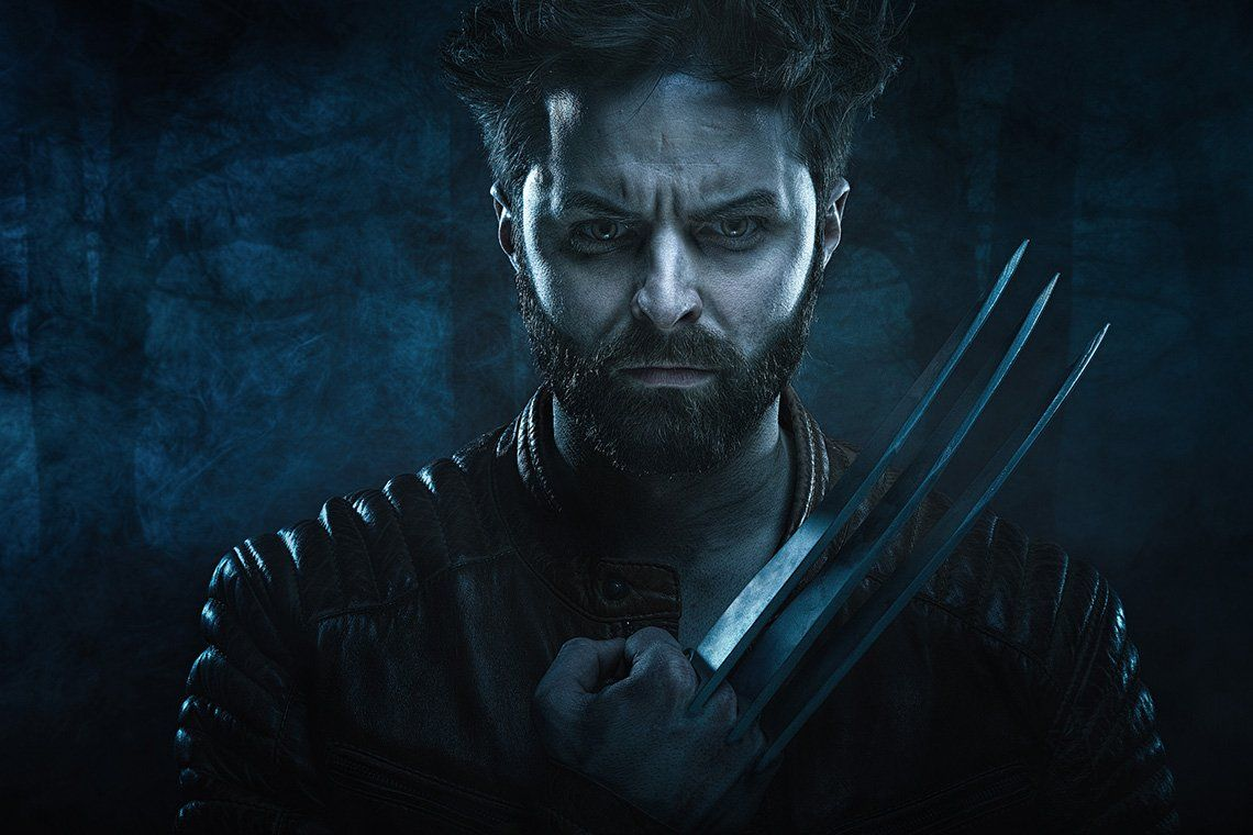 A dark, moody portrait shows a man dressed as Wolverine from the X-Men films.