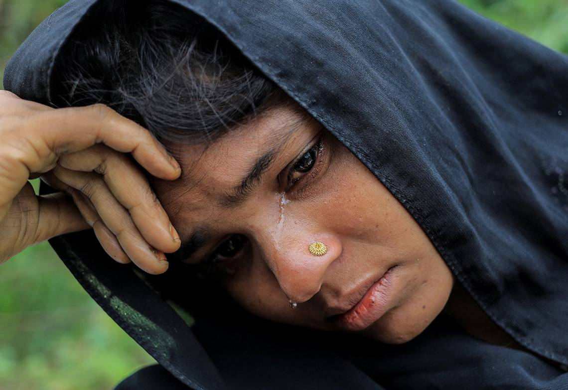 A close up of a crying woman as she waits for shelter in a refugee camp in Bangladesh.