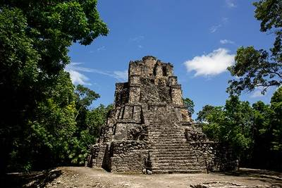 Ancient Aztec ruin in forest