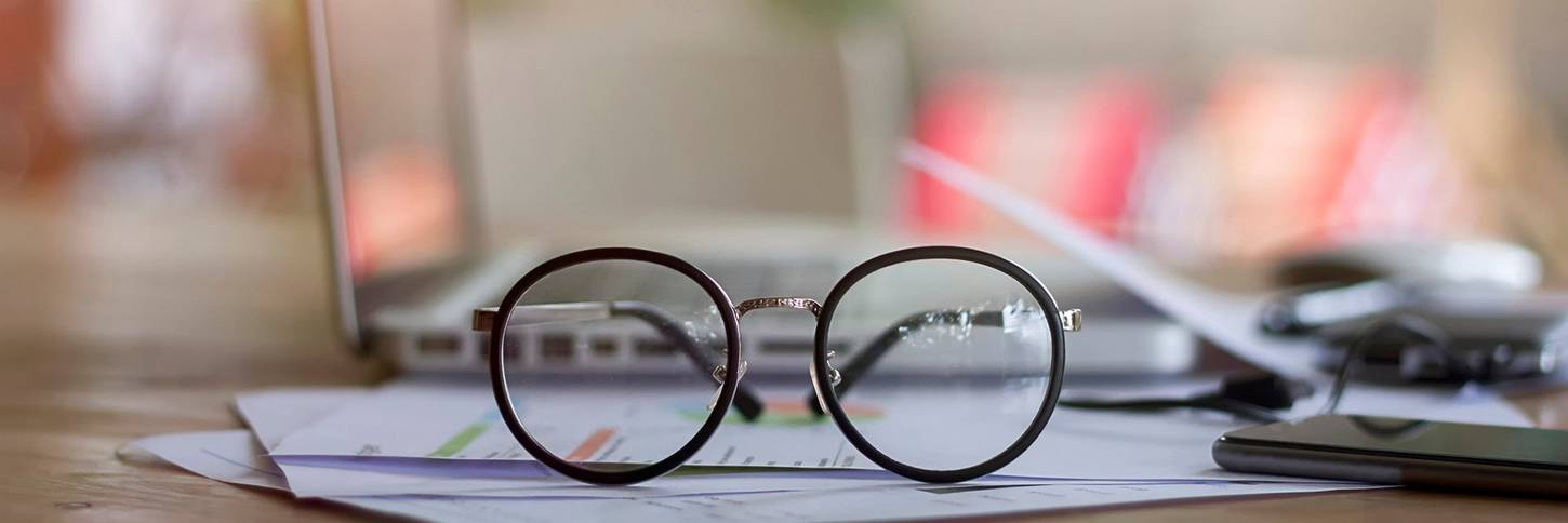 Close-up of Eyeglasses on Desk_Issarapong Suya_GettyImages-728872683