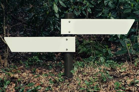 Sign posts pointing in opposite directions