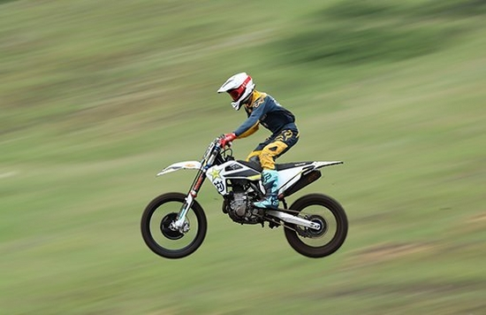 panning shot of bike in the air