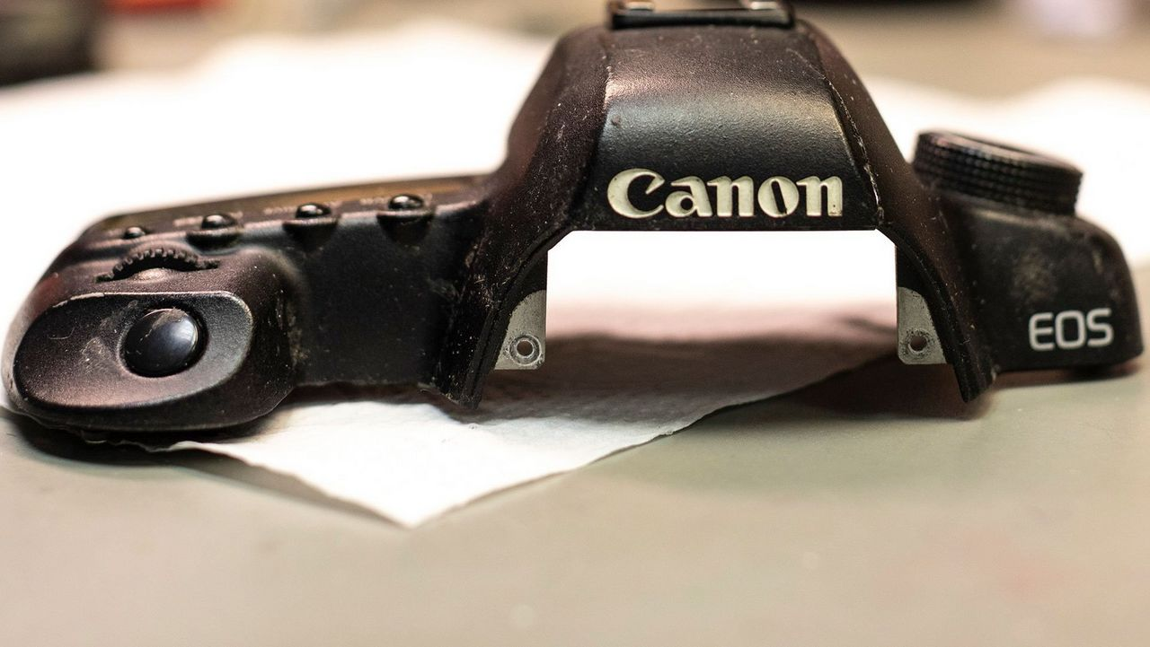 Canon EOS camera body top awaiting repair