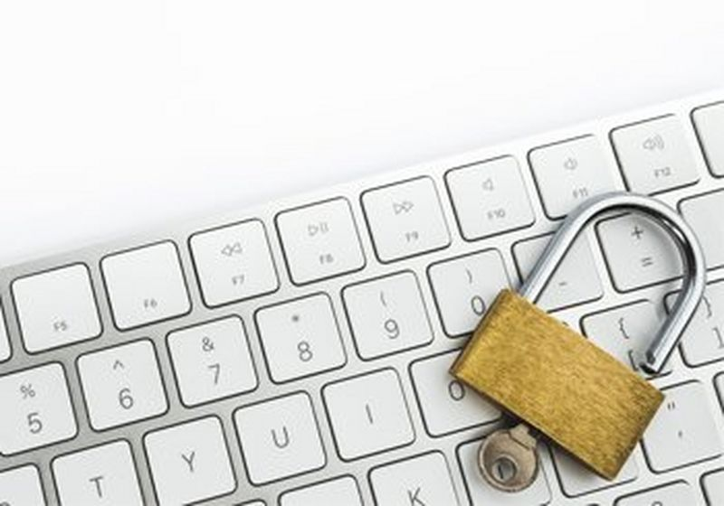 A lock and key, sat on a keyboard