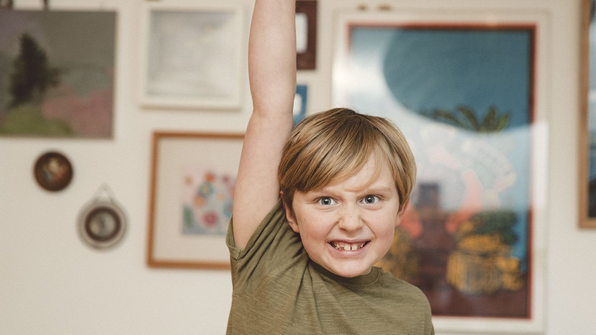Portrait of a boy with his hand up