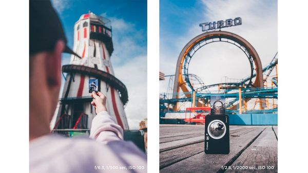 Joel Thorpe holding a print in front of a helter skelter (left). A Canon Zoemini on the boardwalk in front of a rollercoaster in Brighton (right).