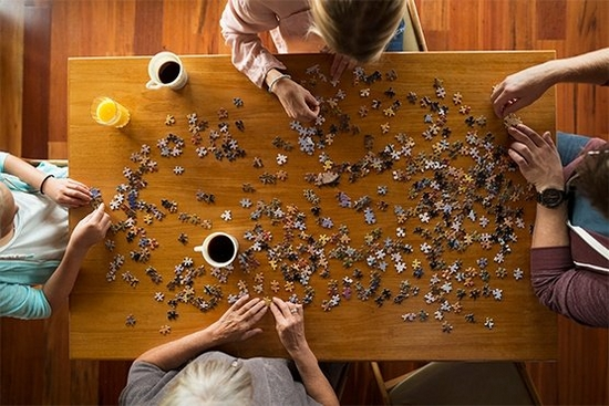 Group of four doing a puzzle