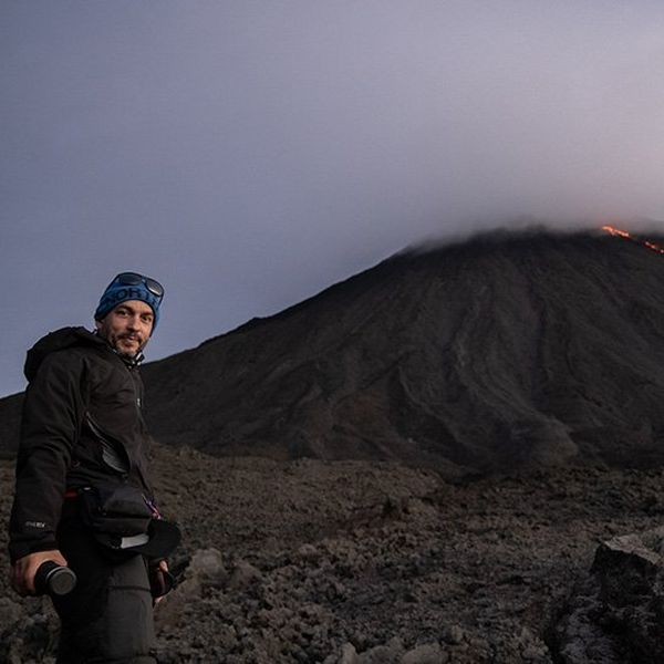 Joel Santos, in front of a volcano