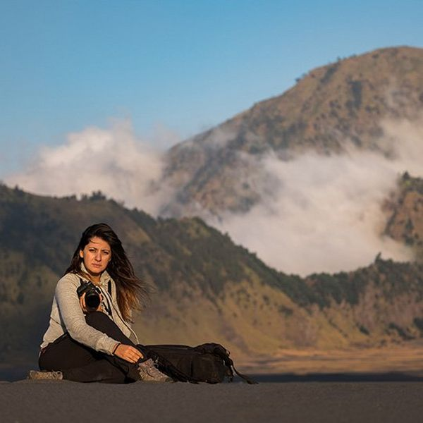 Magali Tarouca sat in front of a volcano