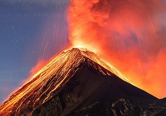 Volcano Fuego spits ash and red-hot lava into the sky.
