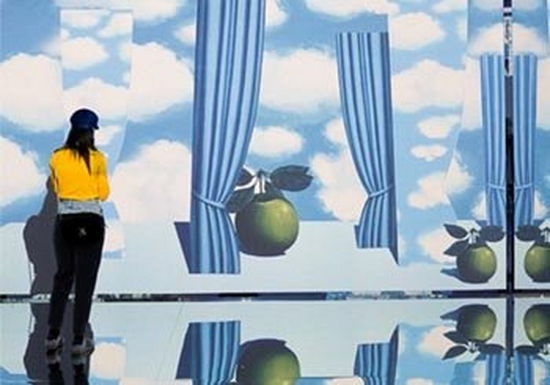 A gallery with mirrored walls and ceilings immerses visitors in projected images of Magritte's paintings.