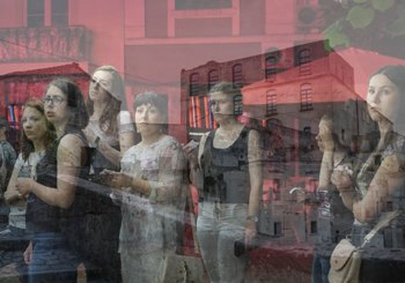 A group of young women, reflected in glass (© Rossena Petcova)