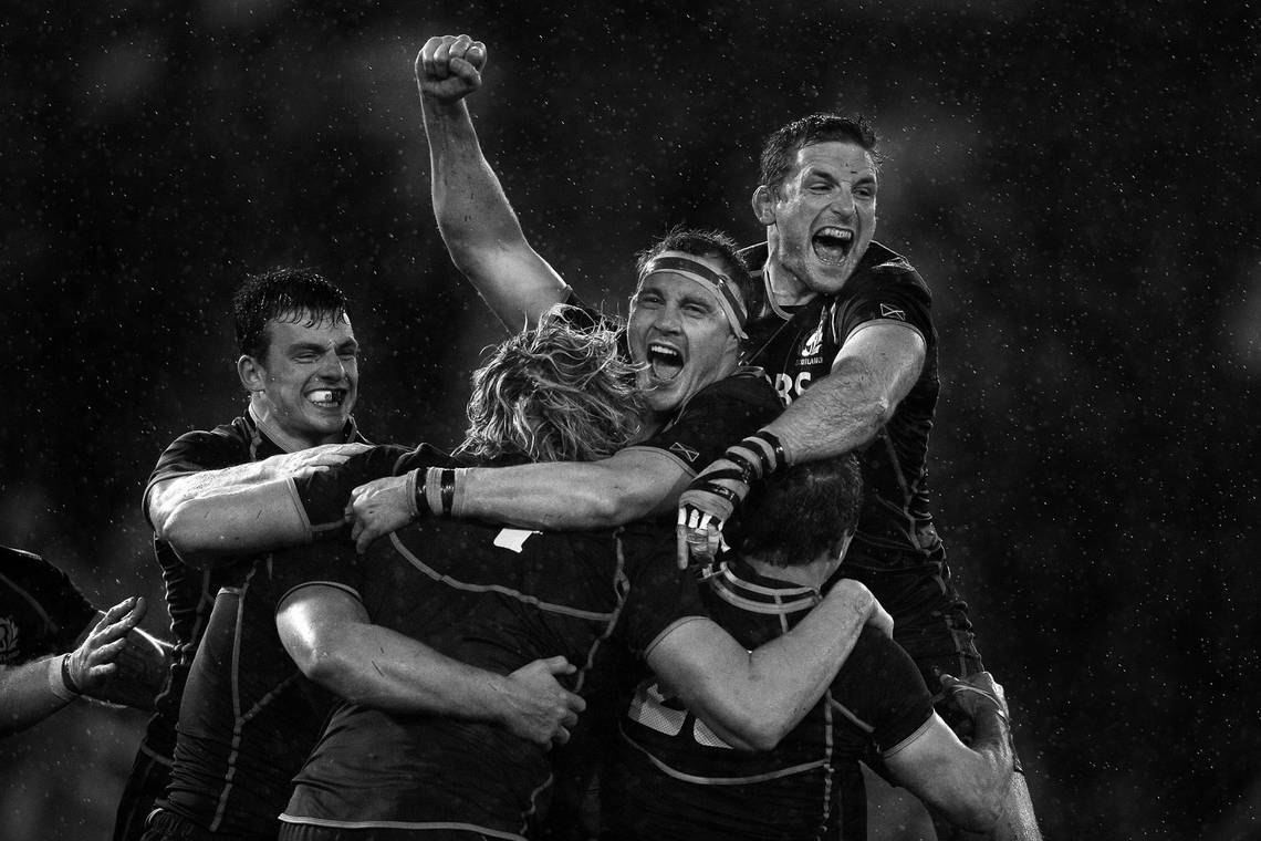 Scotland rugby players celebrating. Photo by Mark Kolbe with a Canon EF 400mm f/2.8L IS II USM lens.