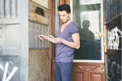 Man reading post