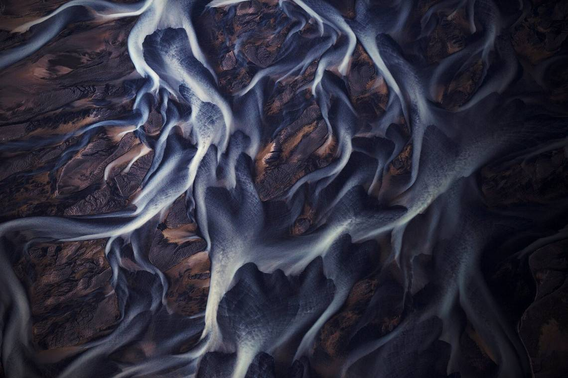 Braided rivers in Iceland photographed from above to reveal their winding patterns. Taken by Lucia Griggi.