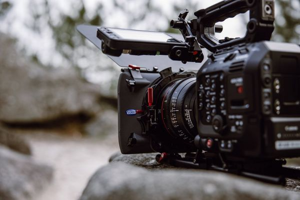 A Canon EOS C500 Mark II on a rock.