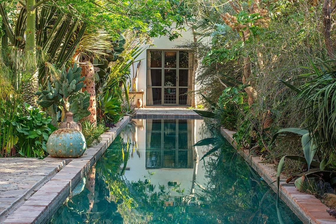 A reflection pool lined with exotic succulents at an eco-garden lodge in Taroudant, Morocco.