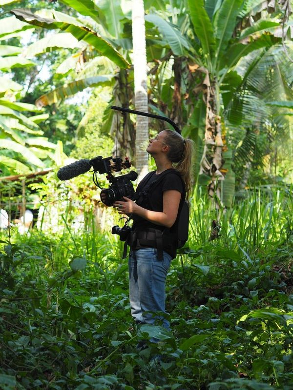 Documentary filmmaker Alice Aedy filming with a Canon EOS C300 Mark II in Sri Lanka.