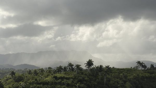 A rain storm approaching the Yunque Mountain at Baracoa in Cuba.