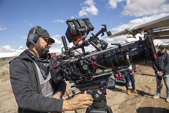 A camera operator using the Canon EOS C300 Mark III on an airfield shoot.
