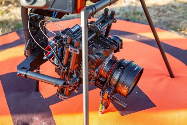 A close-up of the Canon EOS C300 Mark III attached to a drone.