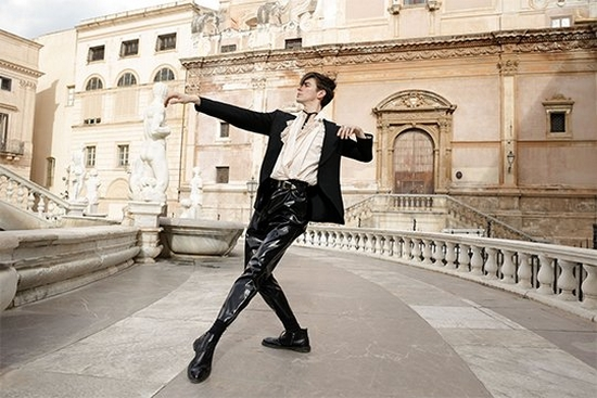 Ballet dancer Lee Jay Hoy poses in front of classical buildings in Palermo, Sicily.