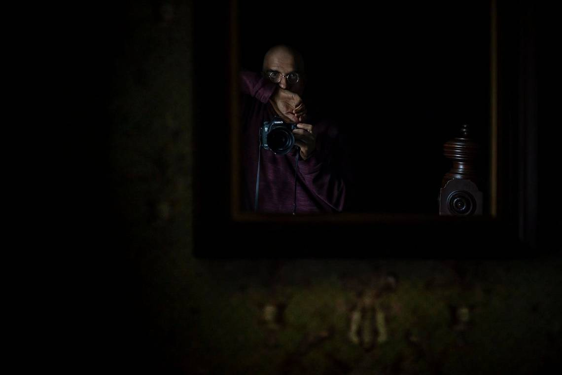 John Stanmeyer takes a self-portrait of his reflection in a mirror.