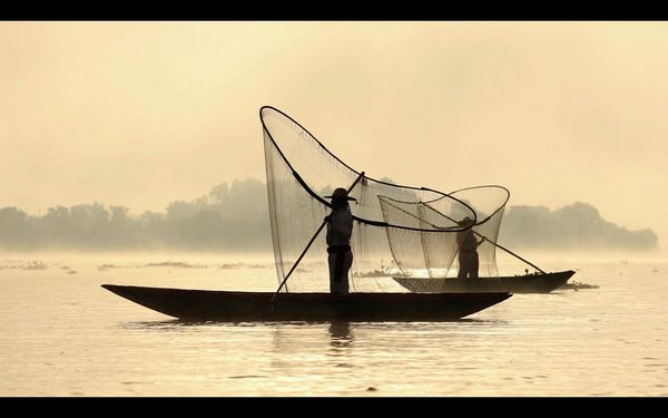 A video still of two traditional fishermen casting their nets, by travel photographer Joel Santos.