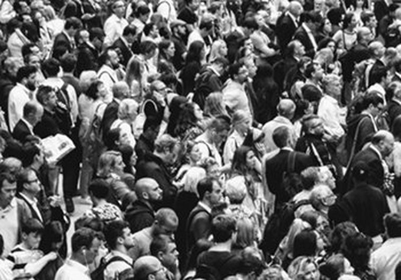 A crowd of people, photographed in black and white