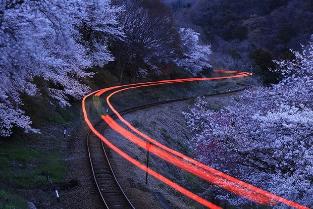 light trails over train track through snow